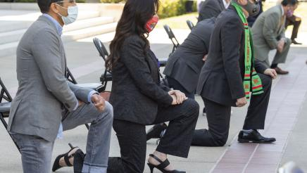 Closeup of Assemblymember Rubio kneeling outside the state capitol in a tribute to George Floyd